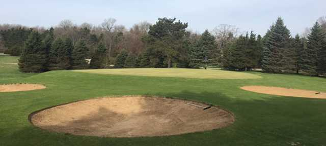A view of a green surrounded by bunkers at White Lake Country Club.
