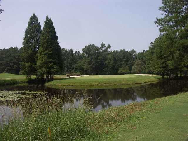 A view of the 14th green surrounded by water at River Course from Country Club of Whispering Pines