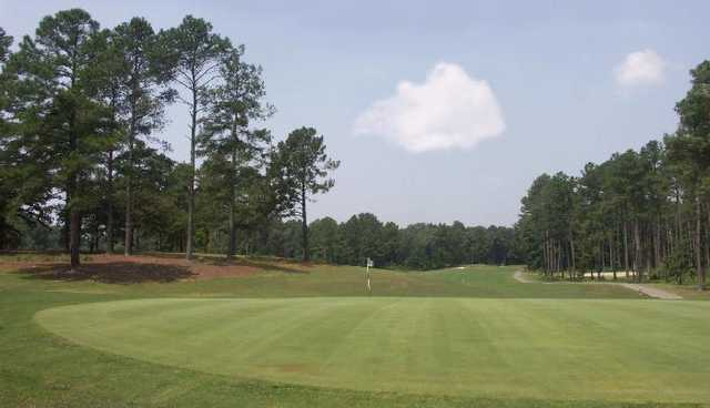 A view of hole #18 with narrow path on the right at River Course from Country Club of Whispering Pines