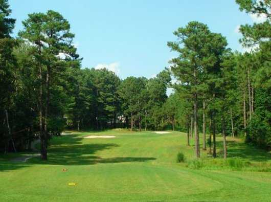 A view of green #16 protected by bunkers at Whispering Woods Golf Course