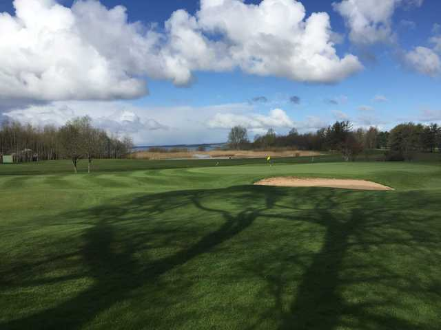 A sunny day view of a hole at Massereene Golf Club.