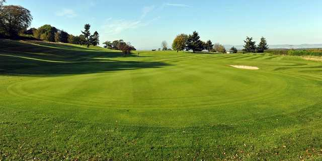 A sunny day view of a green from The Murrayshall Course at Murrayshall Golf Club.
