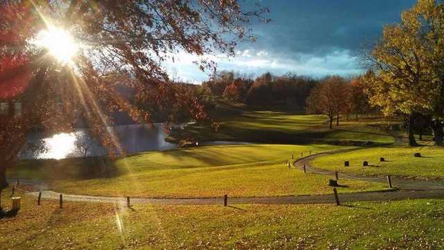 A sunny day view of a green at Duck Hollow Golf Club.