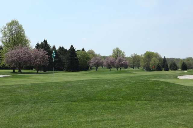 A spring day view of a hole at Tannenhauf Golf Club.