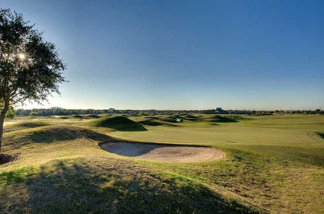 A sunny day view of green #1 at Houston National Golf Club.