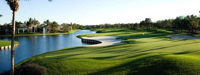 A view of a hole with water and bunkers coming into play at Bay Colony Golf Club.