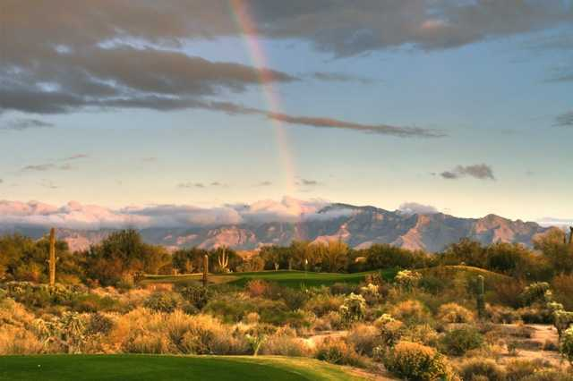 A rainbow view of the 7th green from Highlands at Dove Mountain