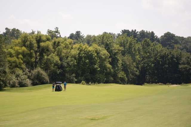 A sunny day view of a fairway at Fairway Hills Golf Club.