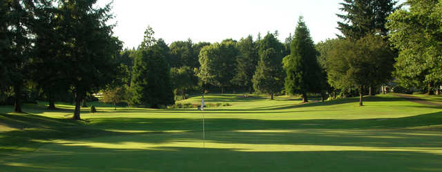 A sunny day view of a hole at Charbonneau Golf Club.