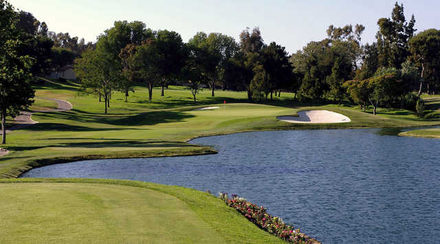 A sunny day view of a hole with water and bunkers coming into play at El Niguel Country Club.