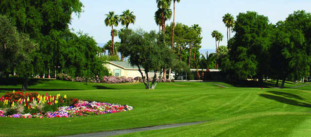 A sunny day view of the red tee at Date Palm Country Club.
