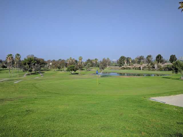 A sunny day view of a hole at Rancho San Joaquin Golf Course.