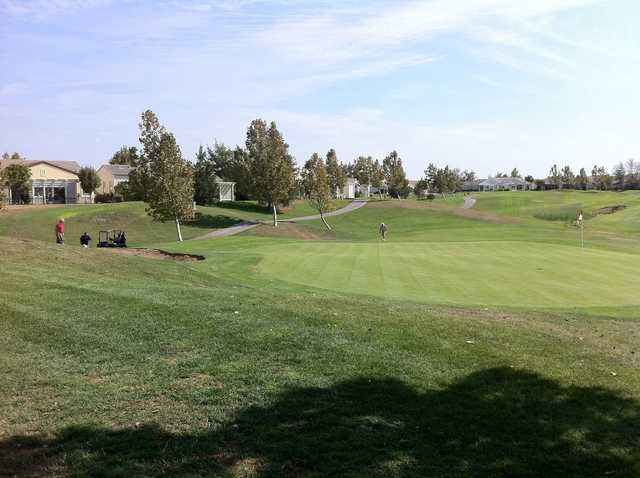 A sunny day view of a hole at Rio Vista Golf Club.