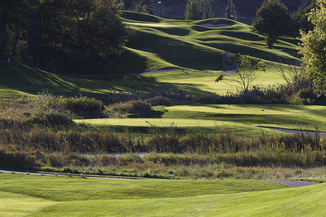 A sunny day view of a tee at Willow Valley Golf Course.