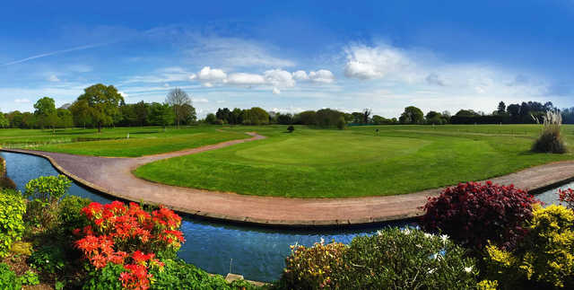 A sunny day view of a green at High Legh Park Golf Club.