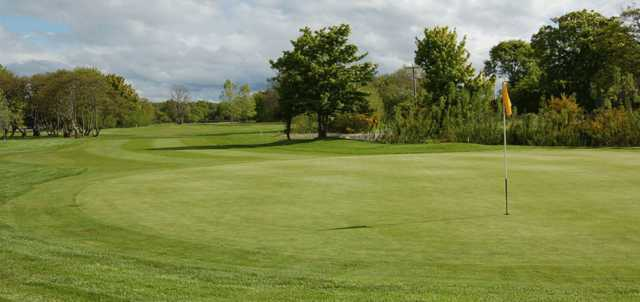 A sunny day view of a hole at Garmouth & Kingston Golf Club.