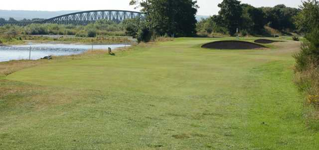 A view of a fairway and a bridge in background at Garmouth & Kingston Golf Club.