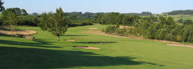 A sunny day view of a fairway at Kirkby Lonsdale Golf Club.