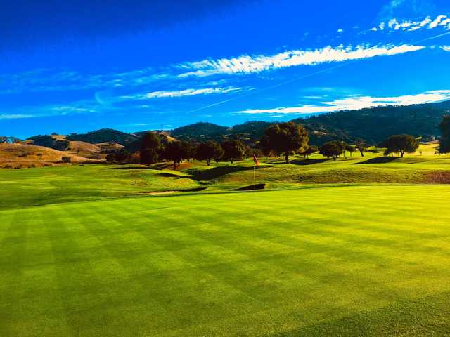 A sunny day view of a hole at San Juan Oaks Golf Club.
