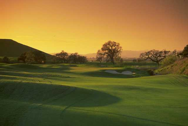 A sunset view of a hole at San Juan Oaks Golf Club.