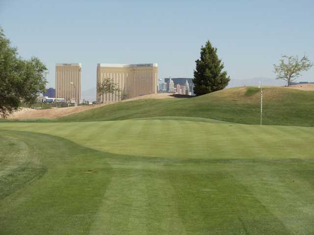 A sunny day view of a hole at Las Vegas Golf Center.