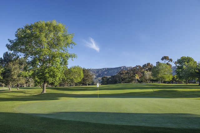 A sunny day view of green #12 at Santa Barbara Golf Club.