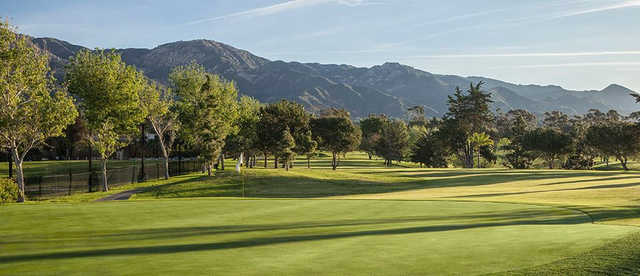 A view of hole #1 and the Santa Ynez Mountains in the distance at Santa Barbara Golf Club.