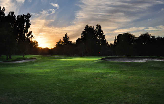 A view of hole #6 surrounded by sunset light at Ancil Hoffman Golf Course.