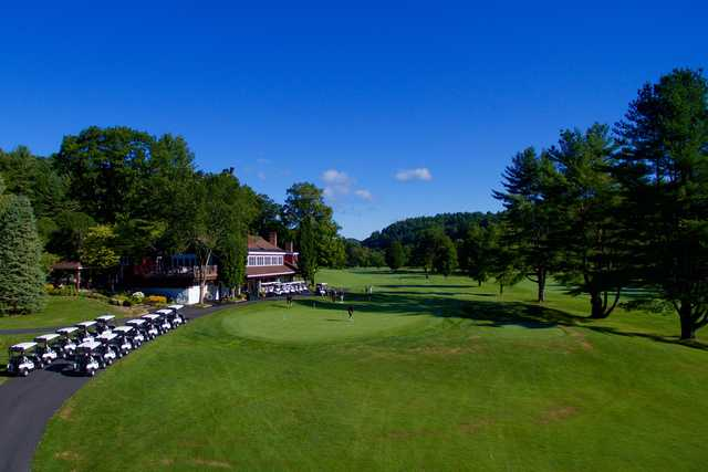 A view of the clubhouse and putting green at Woodstock Country Club