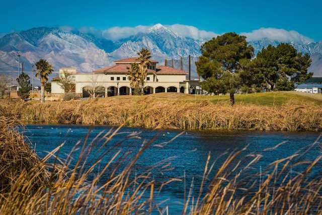 A view over the water of a green and the clubhouse in the distance at China Lake Golf Course.
