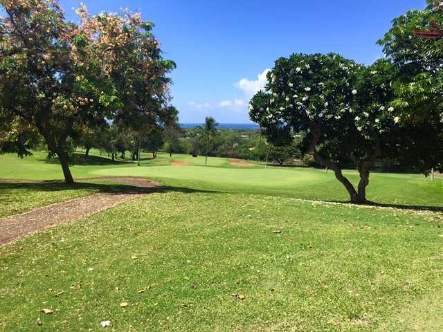 A sunny day view of a green at Makaha Valley Country Club.