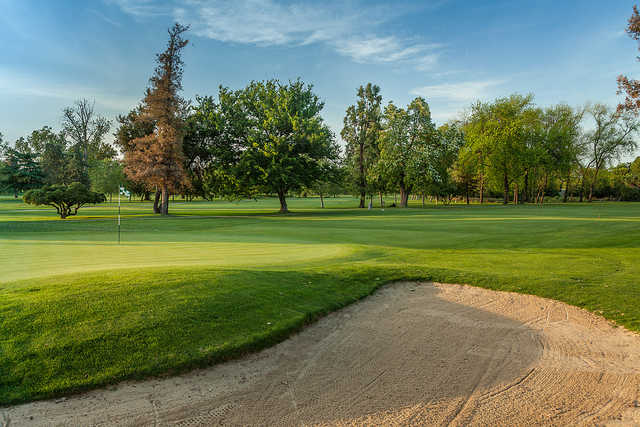 A sunny day view of a hole at Stockton Golf & Country Club.