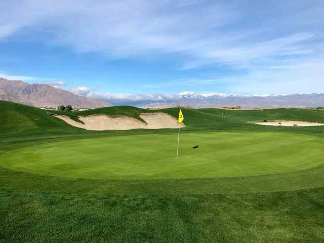A sunny day view of a green at Cimarron Golf Club.