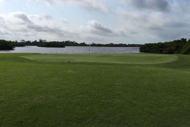 A view of a hole with water in background at Lake Venice Golf Club.