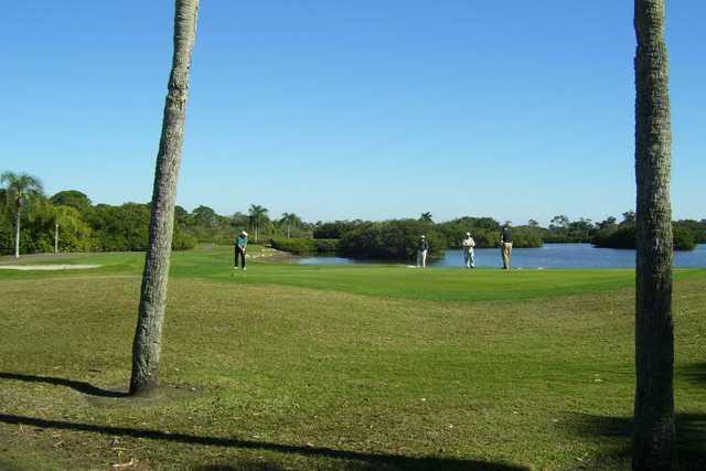 A view of a green near the lake at Lake Venice Golf Club.