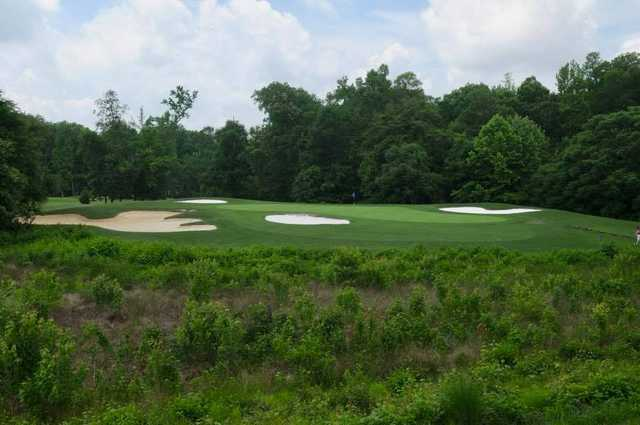 A view of a hole surrounded by a collection of bunkers at Lee's Hill Golf Club.