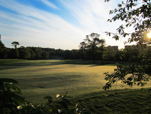A sunset view of a green at University of Maryland Golf Course.