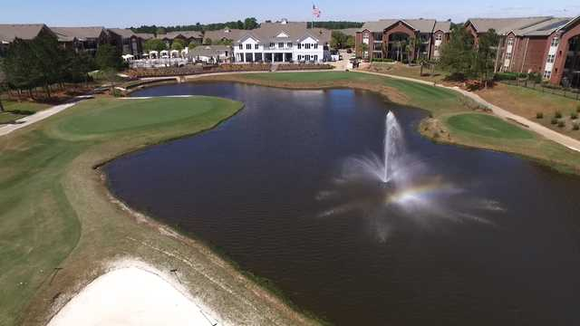 View of the finishing hole and clubhouse at The Nine at ONE CLUB