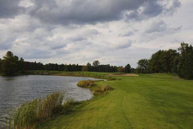 The par-4 13th hole on the Monarch Course at Garland Lodge & Resort features large traps on either side of the fairway