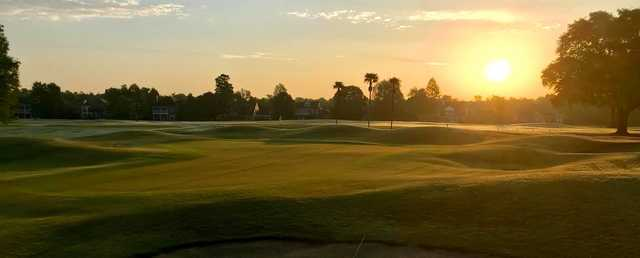 A sunset view of a hole at English Turn Golf & Country Club.