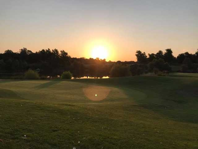 A sunset view of a hole at Turkey Creek Golf Club.