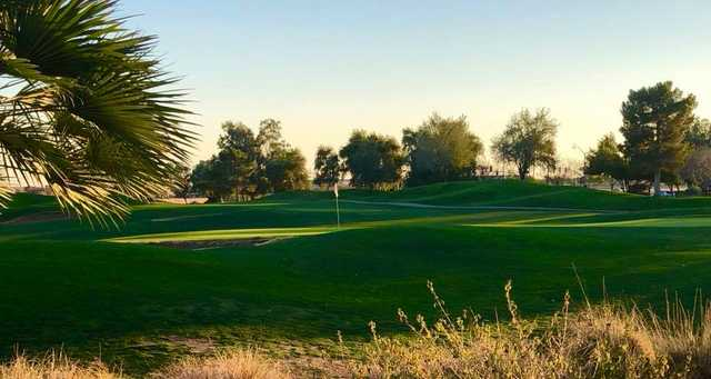A sunny day view of a hole at Arizona Traditions Golf Club.