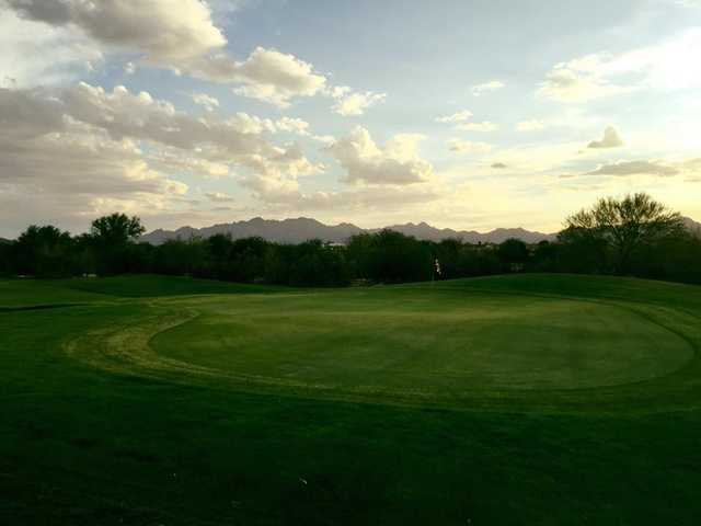A sunset view of a green from Coyote Wash Golf Course.