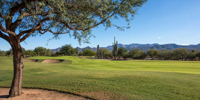 A sunny day view of a green at Tonto Verde Golf Club.