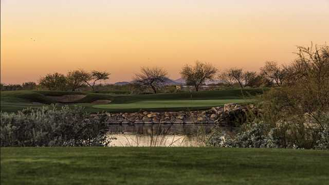 A sunset view of a green at Whirlwind Golf Club.
