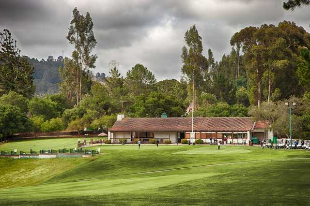 A view of the clubhouse and practice area at Lake Chabot Golf Course.