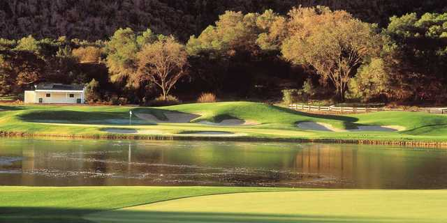 A view of a green with water and bunkers coming into play at Rancho San Marcos Golf Course.