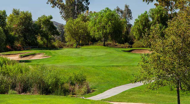 A view of a green flanked by bunkers at Reidy Creek Golf Course.
