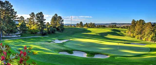 A view of a well protected hole at Castle Pines Golf Club.