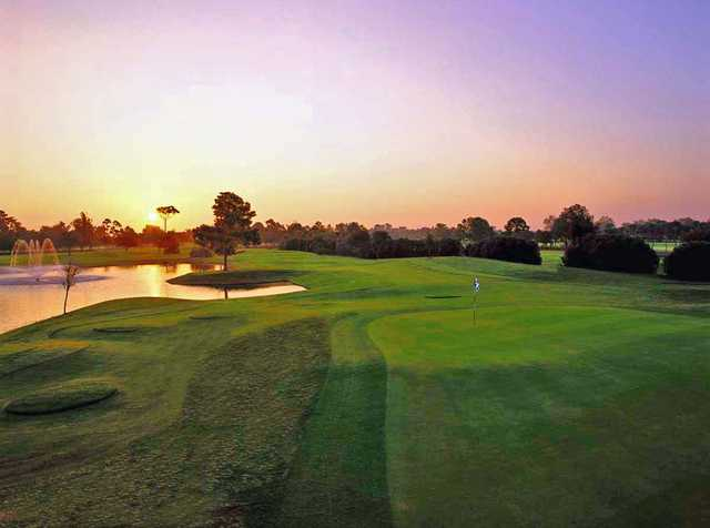 A sunset view of a hole at Bardmoor Golf & Tennis Club.
